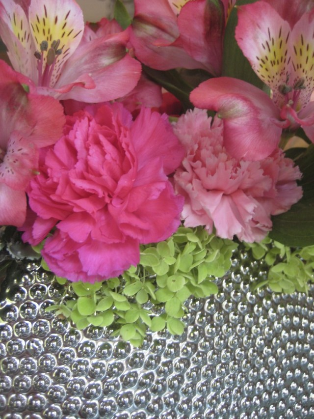 Pink and Green Floral Arrangement In Silver container