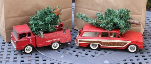 Chartreuse Barn Sale- Vintage toy fire truck and station wagon with tree on top