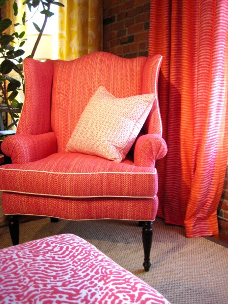 Wing chair and drapes in coral_ St Croix patterned bench