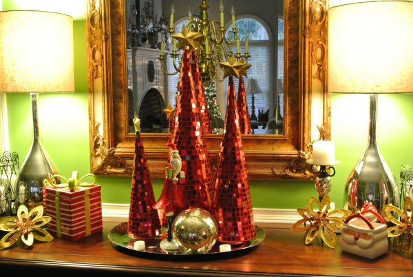 Christmas Decorating Is Easy With Cone Shaped Trees- Buffet decorations with red mirrored cone shaped trees, gold stars, and mercury ball