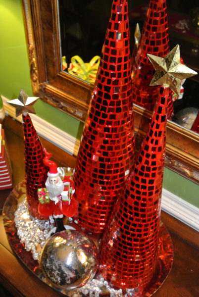 Christmas Decorating Is Easy With Cone Shaped Trees- Red mirrored cone shaped Christmas trees with Gold stars