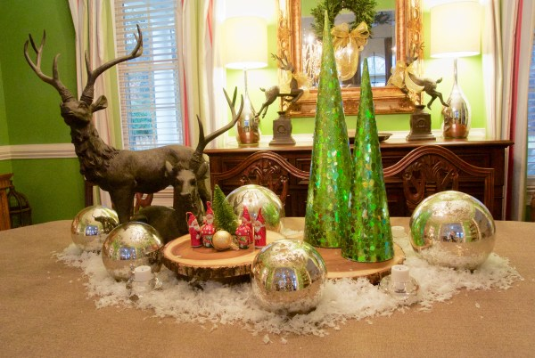 Christmas Decorating Is Easy With Cone Shaped Trees- Winter tablescape with deer, wood slices, green cone shaped trees and mercury balls and snow