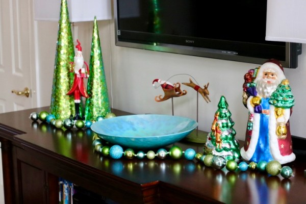 Christmas Decorating Is Easy With Cone Shaped Trees- canal trees with flying santa and large glass figurines