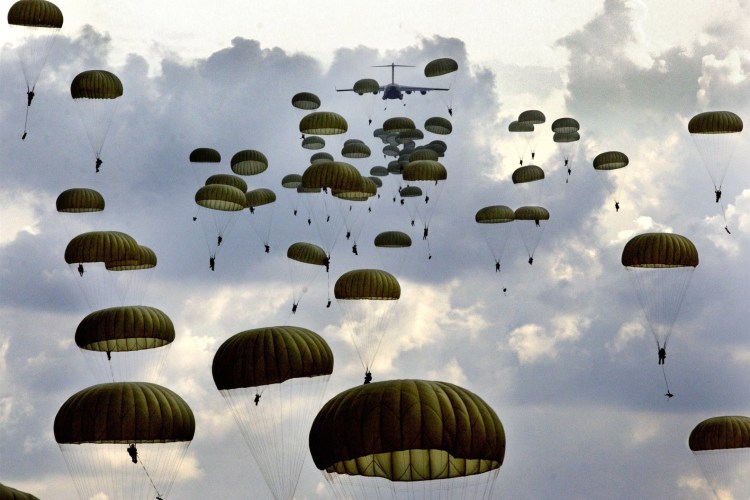 ** ADVANCE FOR WEEKEND EDITIONS OF FEB. 18 - 19 - FILE **  Paratroopers Of The Army's 82nd Airborne Division  Drop Into Fort Bragg, N.C.'s Sicily Drop Zone, Oct. 7, 2003. Formed In World War II, The 82nd Airborne Jumped Into Italy, Flew On Gliders Into Normandy And Later Parachuted Into Holland. Today, The 82nd Serves As The Nation's Ready-reaction Force, With One Brigade Of Paratroopers Always Available To Jump Into A Fight Should The President Call.  But The Last Time The 82nd Actually Parachuted Into Combat Was In 1989, Landing In Panama To Help Oust Dictator Manuel Noriega. (AP Photo/The Fayetteville Observer, David Smith, File) **MAGS OUT, NO SALES**