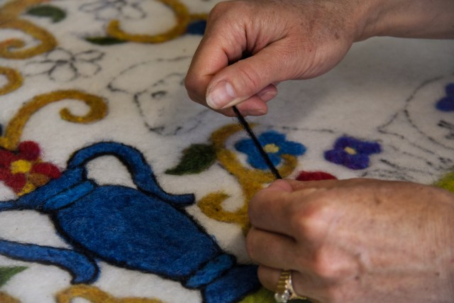 Needle felting a sheep rug.