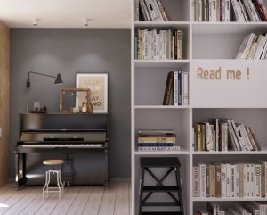 Plenty of shelving for books and a nook for a piano are a bold indication that the apartment  is a home and not just a showcase for design elements.