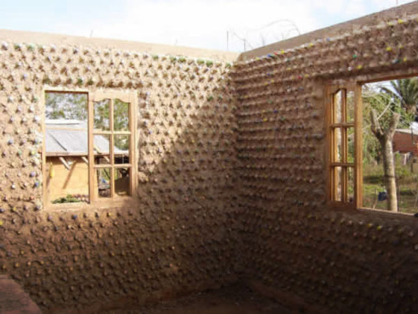SAND AND PLASTIC: A House Made Entirely of Plastic Bottles In ... Bottle House Designs on toothpick house designs, box house designs, wooden doll house designs, birdhouse house designs, glass house designs, playing card house designs, miniature house designs, pump house designs, boxcar house designs, tube house designs,