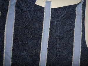 The op-shop little blue dress unpicked so that I can attach strips of cotton fabric easily by machine. These 3 strips are to act as a guide so that I get all the patches straight.