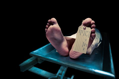 Bare feet with toe tag in a morgue  Picture from Depositphotos.com