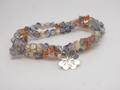 Rock crystal with clover charm