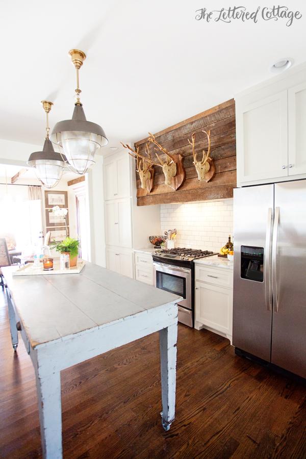 Blue-Kitchen-Island-Farm-Table-Rattan-Taxidermy-Rustic-Wood-Stove-Hood-Old-House-Kitchen-Ashley-Gilbreath-Montgomery-Alabama