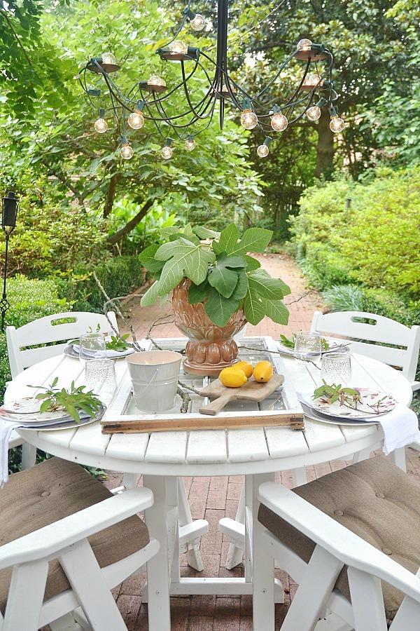Summer patio table with a window table runner & DIY outdoor chandelier. lizmarieblog.com