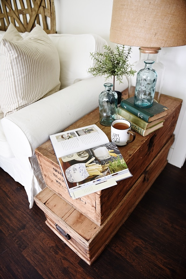 Elegant Lovely neutral cottage style living room stacked trunk end table Cozy rustic farmhouse style