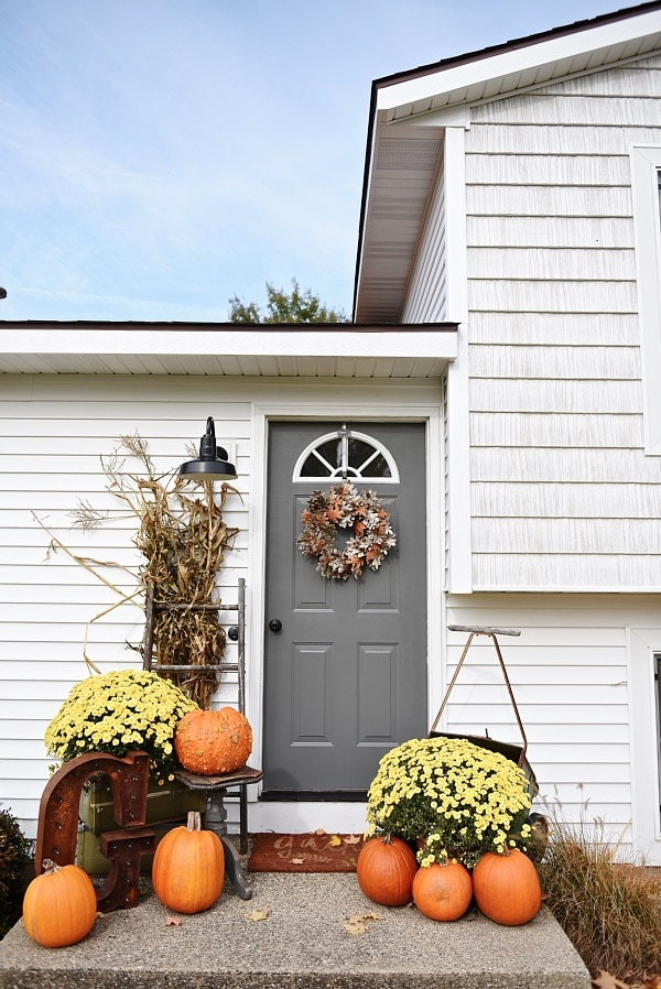 Simple fall porch decor & a door makeover - Door color is Kenadall Charcoal by Benjamin Moore