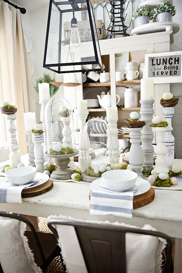 Simple Easter Dining room tablescape - rustic cottage easter decor with handmade candle holders, eggs, moss, & other touches. A must pin for Easter decor!