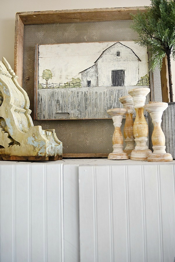 Farmhouse style vignette - A rustic barn painting in a farmhouse living room. A great pin for farmhouse decor ideas!!