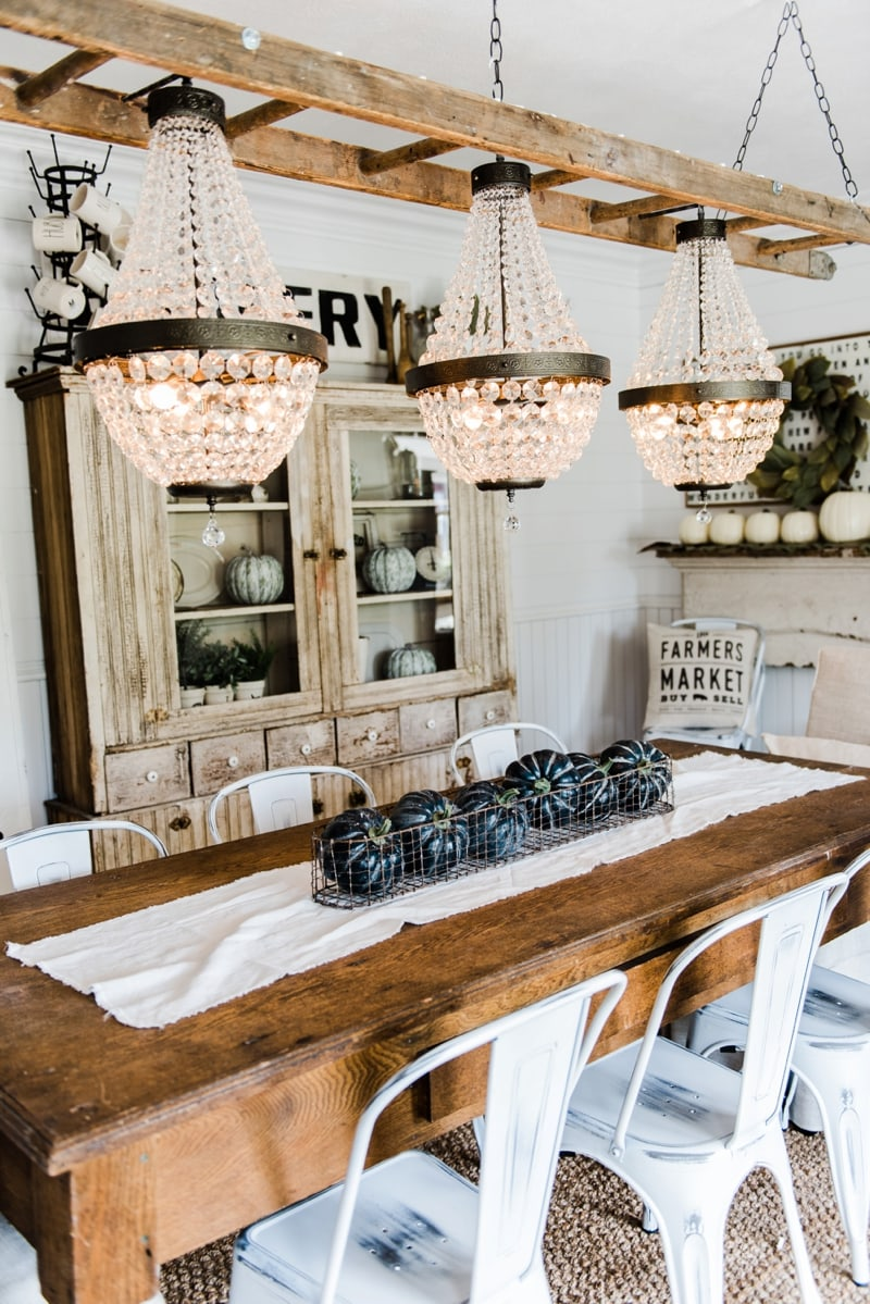 The chandeliers are hung liz marie blog farmhouse dining room makeover crystal chandelier update arubaitofo Image collections
