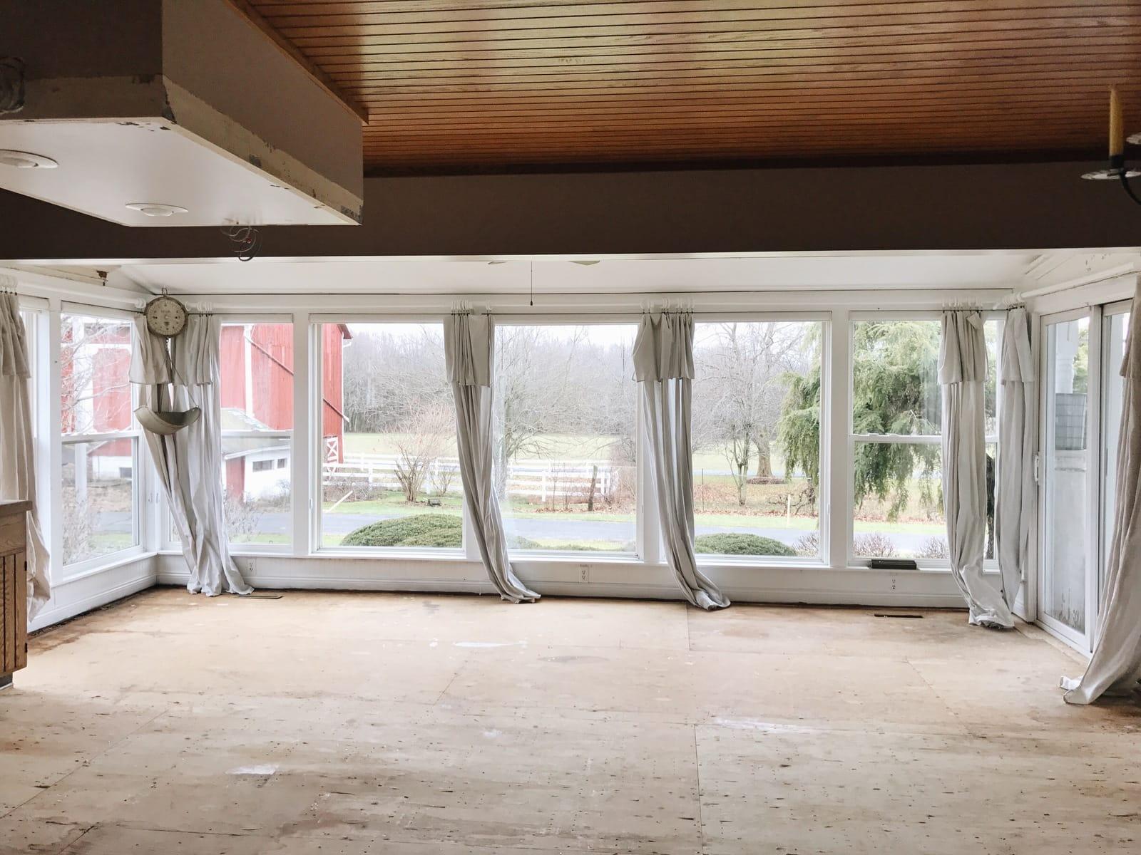 Sunroom & Kitchen Demo- The Floors are Gone! - Liz Marie Blog