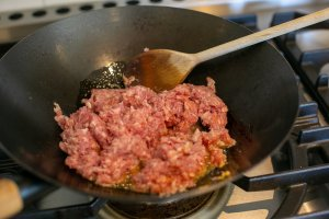 pork mince in a frying pan for Chilli Pork Noodles with Peanut Sauce