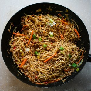Chilli Pork Noodles with Peanut Sauce in a wok