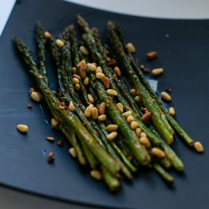 spicy roasted asparagus served on a plate