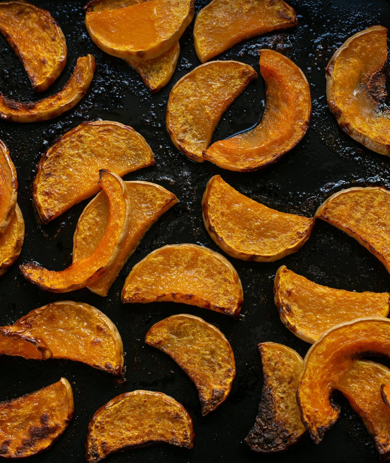 crispy roasted squash on a baking tray