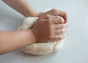 maneesh bread dough being kneaded and shaped by hand