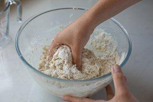 maneesh bread dough being stirred by hand