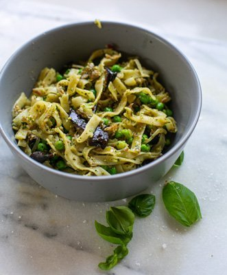 freshly cooked aubergine pesto pasta served in a bowl