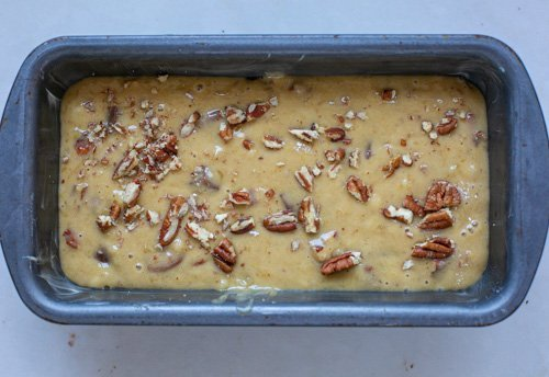 Chocolate pecan banana bread mixture in a loaf tin, ready to bake