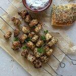 chicken kebabs served with greek yoghurt dip