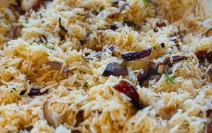 cooked dirty rice in a pan with onions and spices
