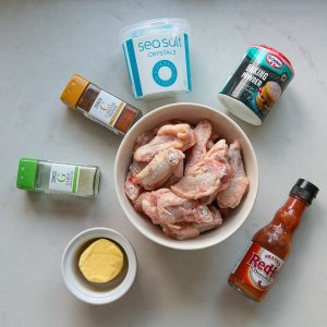 all the ingredients needed to make Oven Cooked crispy buffalo wings