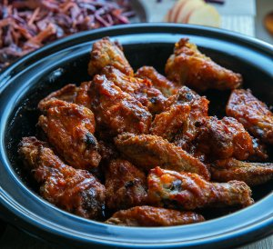 freshly cooked Oven Cooked crispy buffalo wings served with coleslaw