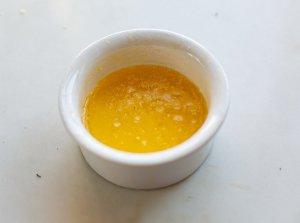 melted butter in a ramekin
