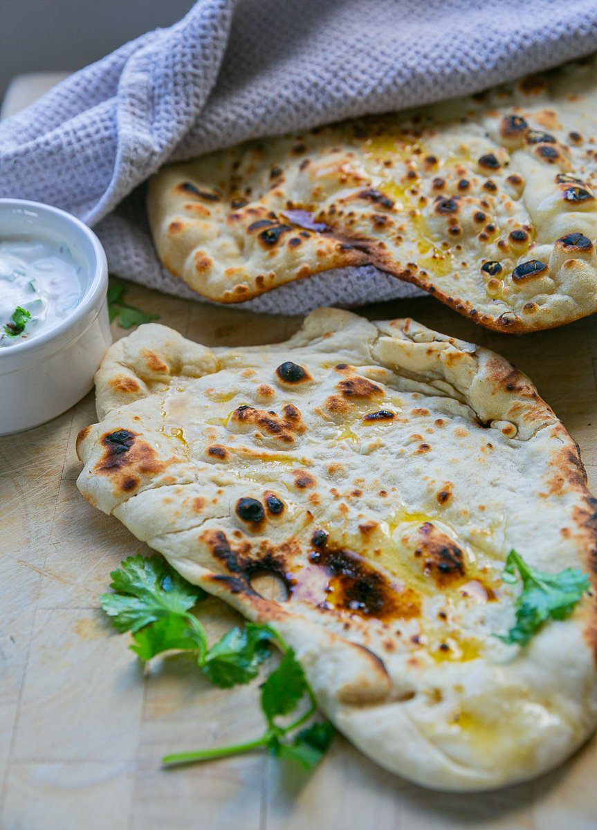 freshly cooked naan served with melted butter and coriander