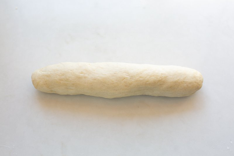 Rolled dough ready for flatbreads on a kitchen work surface