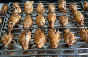 Oven Cooked crispy buffalo wings on a baking tray