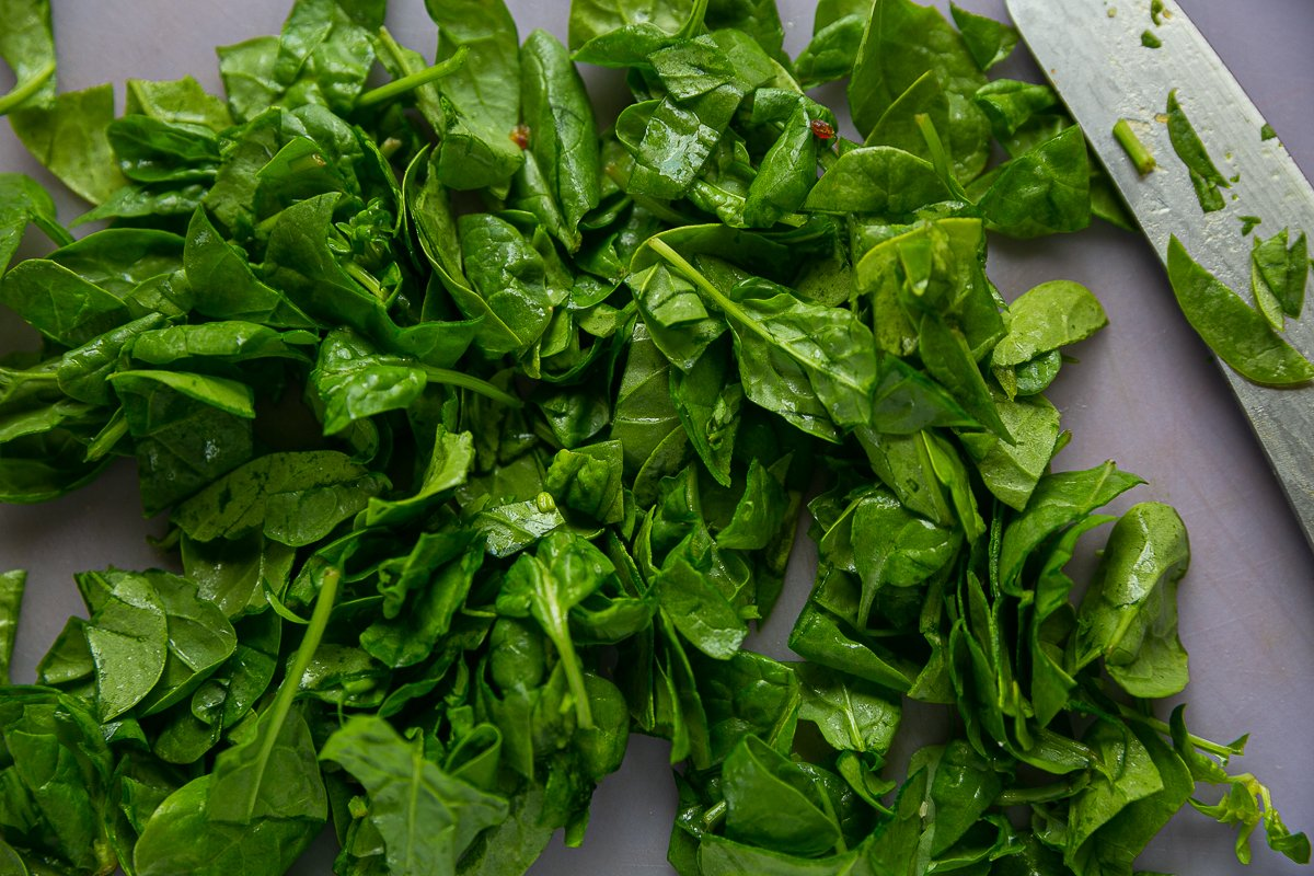 Washed baby spinach roughly chopped