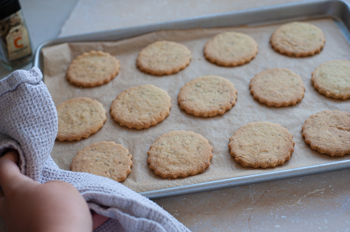 freshly cooked Lime and Cardamom Biscuits on a baking tray