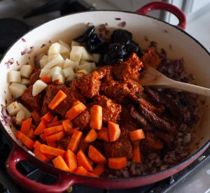 all the ingredients to make middle eastern beef stew in a pan
