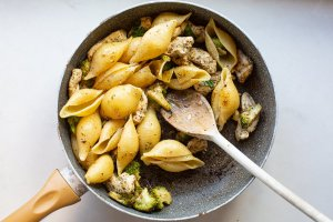 chicken broccoli pasta cooking in a pan