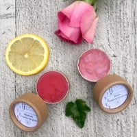 rosie rhubarb organic lip gloss in biodegradable packaging