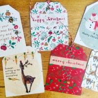 christmas gift tags embedded with plant seeds