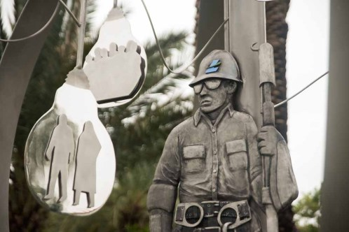 At the center of the monument: a lineman