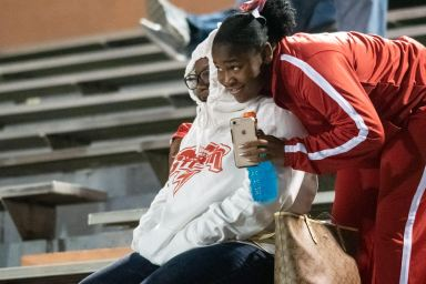 Kathleen cheerleader De'Asioca Lisbon joins her mother, Charnecia Lisbon, in the stands.