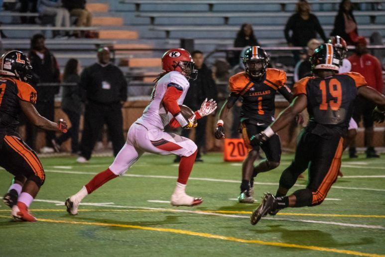 Torean Sealey, KHS Red Devils, wide receiver tries to get the ball away from their own end zone.
