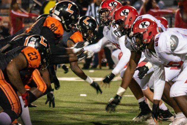 Lakeland High School Dreadnaughts and the Kathleen High School Red Devils face off a the line of scrimmage.