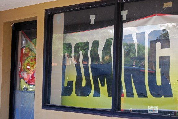 """A """"coming soon"""" sign for Marco's Pizza hangs in the window at 719 E. Palmetto St."""