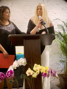 Laura Lear speaks after being presented the Athena Young Leadership Award from Southeastern University's Eunice Hutto.